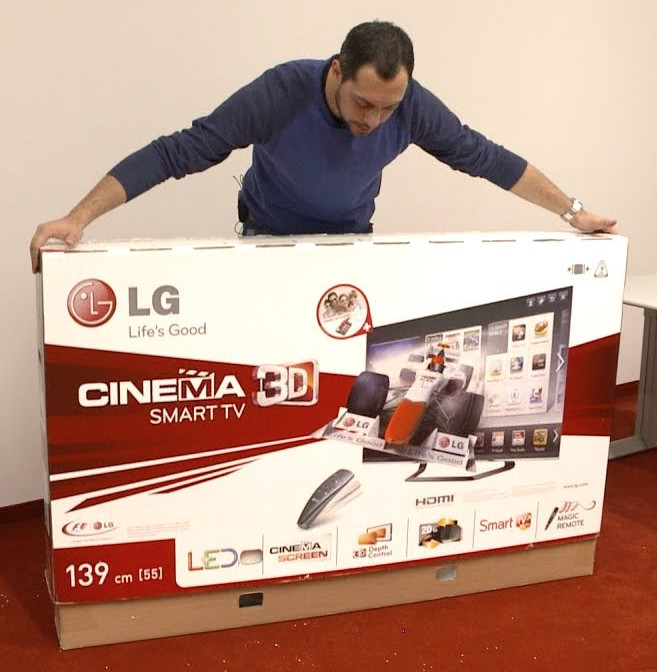 Unboxing and preparing to perform a TV wall mount installation